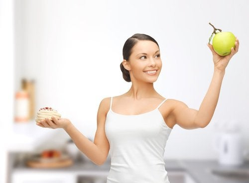 A woman choosing to eat healthy fruits.