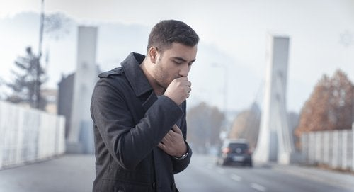 Man coughing on the street in winter remedies for a cough