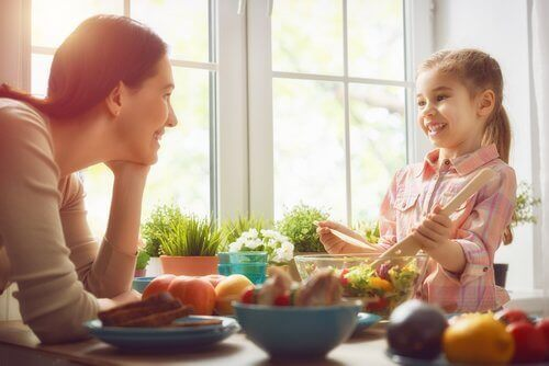 Mother talking to daughter eating well and being happy vitamins