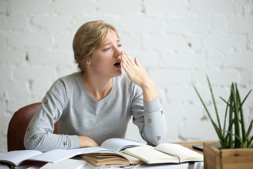 Exhausted woman yawns cant concentrate need to detox