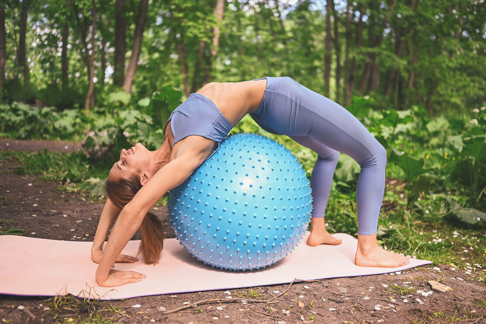 A woman with an exercise ball.
