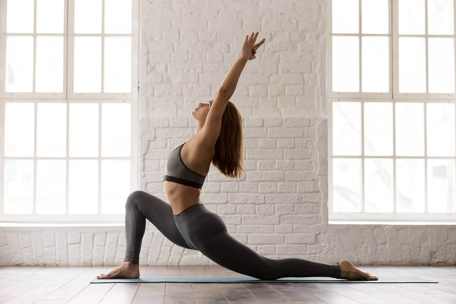 A woman doing a back stretch.