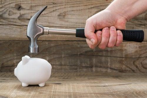 A piggy bank and a hammer.