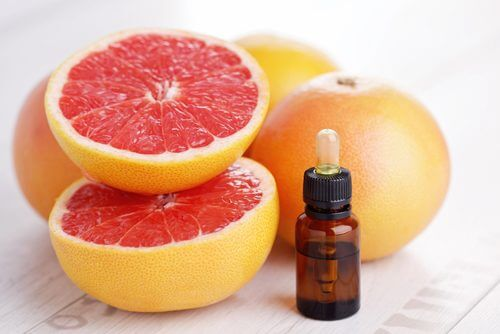 Grapefruits and bottle of grapefruit seed extract on a table