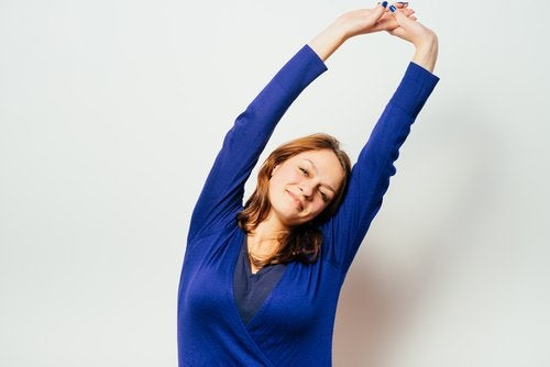 Woman doing exercises to relieve muscle aches