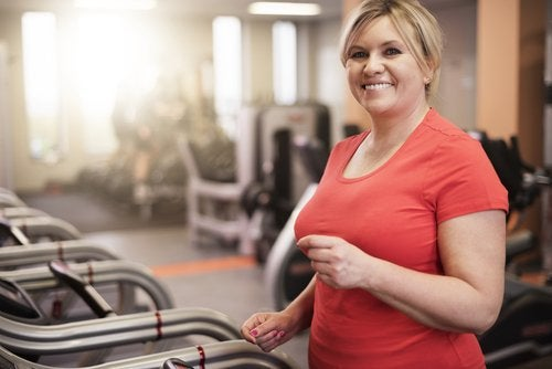 Overweight woman working out at the gym