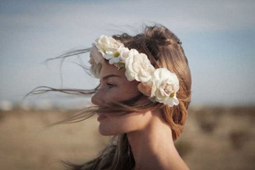 Woman with flower crown wind blowing accept your present situation