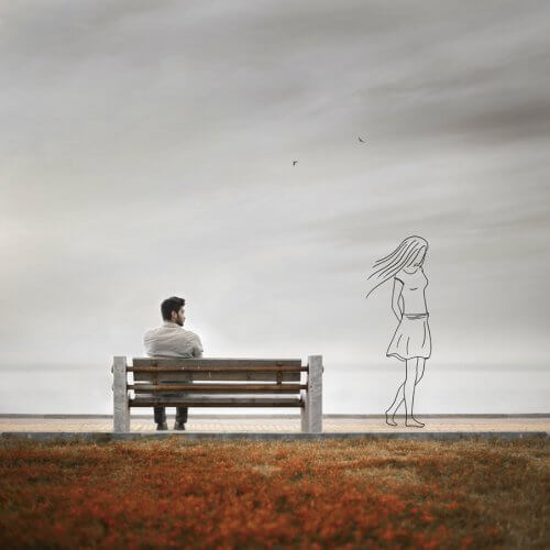 A man sitting on a bench looking at the outline of a woman
