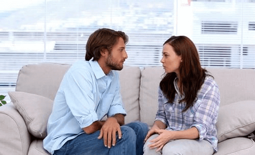 Couple talking unfit partner