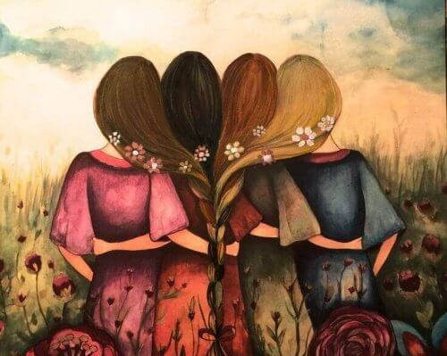 Four girls with their hair entwined.