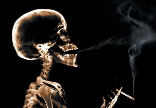 Image of skeleton in an x-ray smoking a cigarette