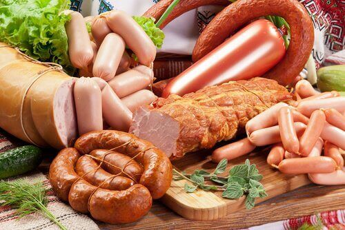 Processed and red meats on a cutting board problems with your joints