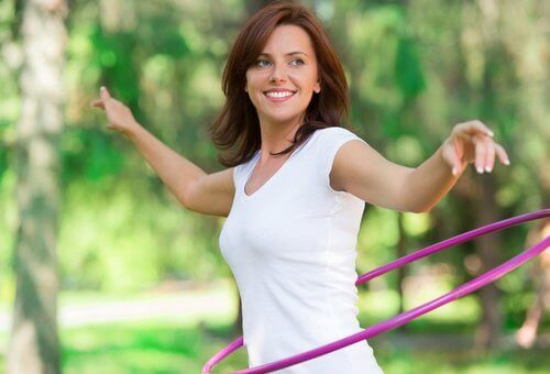 woman practicing hula hooping to show her strength