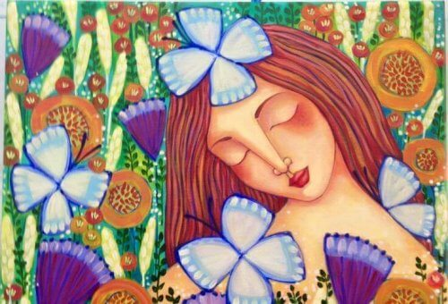 Happy woman surrounded by butterflies