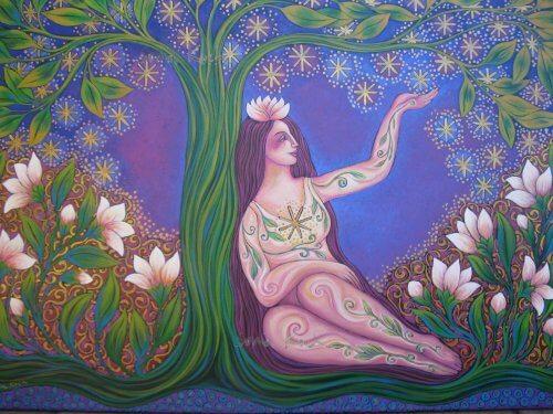 Peaceful woman beneath a tree