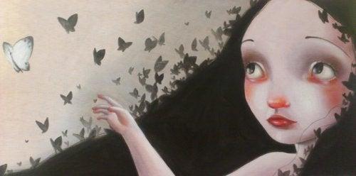 A girl watching some butterflies.