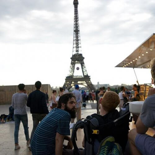 Kevan looking at the Eiffel tower with his friends