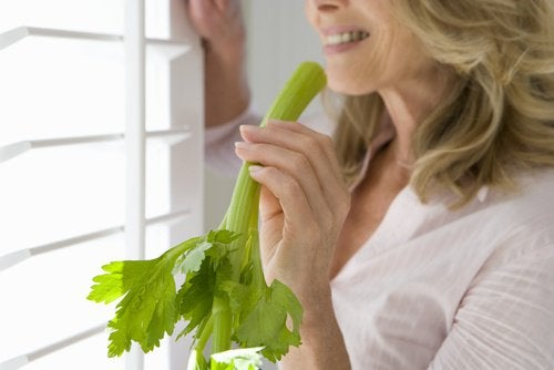 Older woman enjoying the benefits of celery