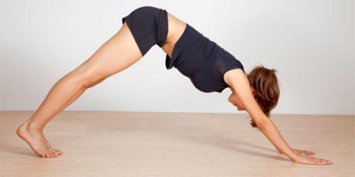 Downward dog yoga pose to slim down