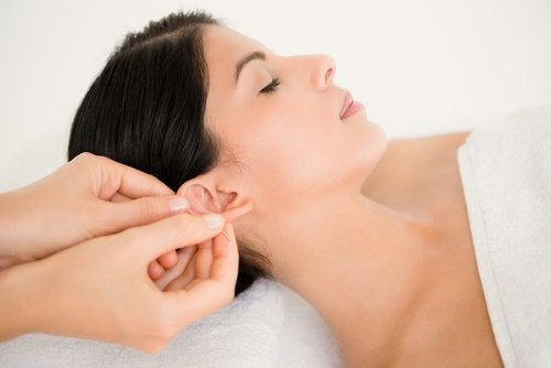Woman getting an ear massage