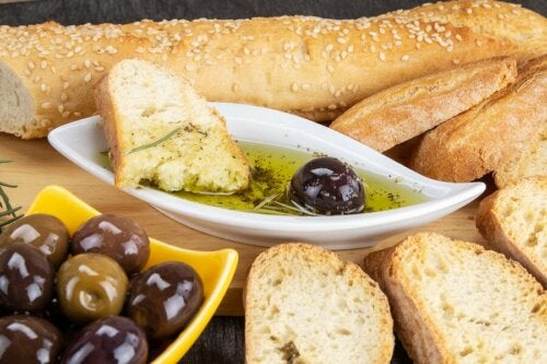 A loaf of bread and olive oil.