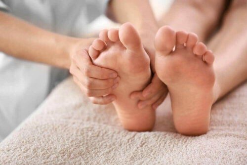 A person trying to relieve bunion pain.