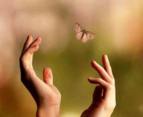 The butterfly represents the unfinished business the hands are letting go of.