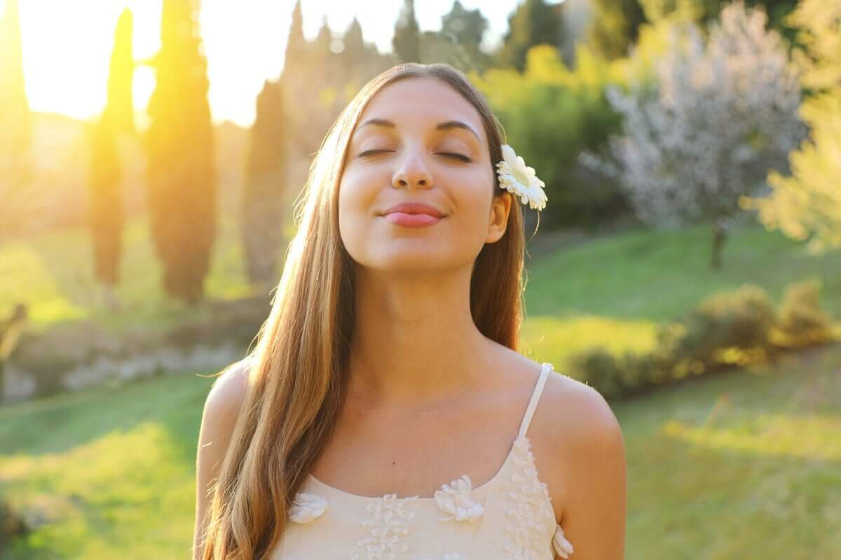 A woman breathing in fresh air.