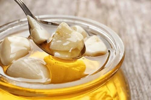 A jar of honey and garlic gloves.