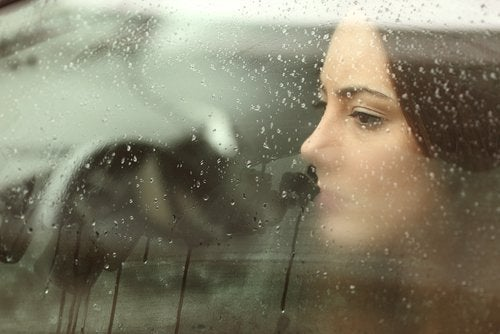 Girl looking out window raining feeling sad fight homesickness