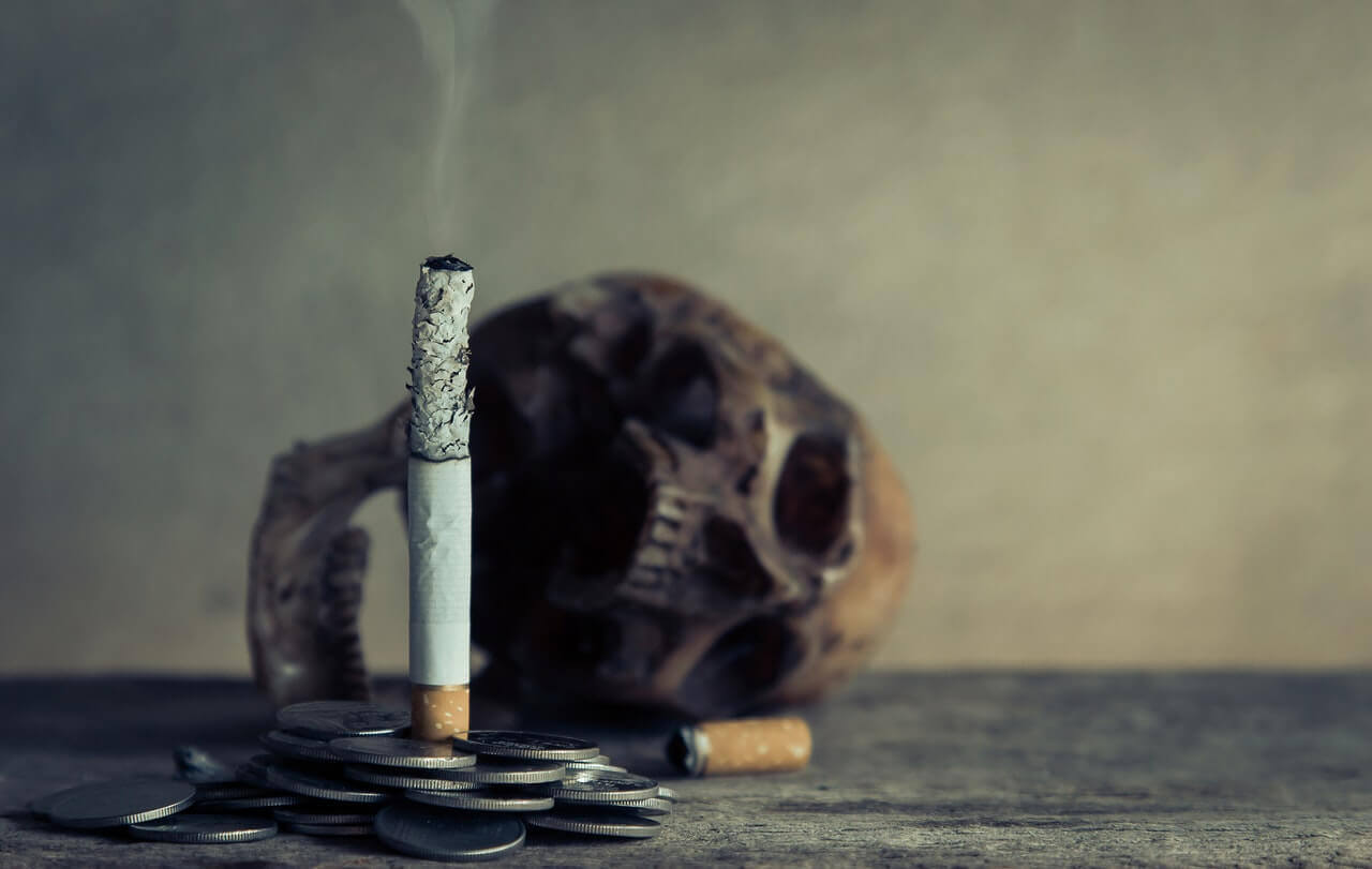 A burnt cigarette and a skull.