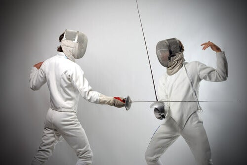Two people practicing fencing.