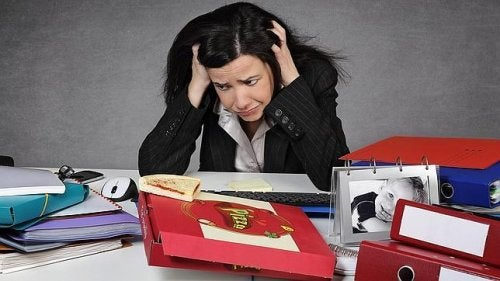 Stressed woman with a lot of work
