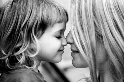 A little girl touching her nose with her mother.