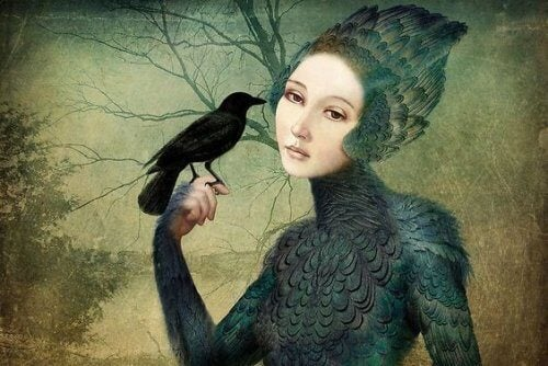 Woman holding a crow on her finger