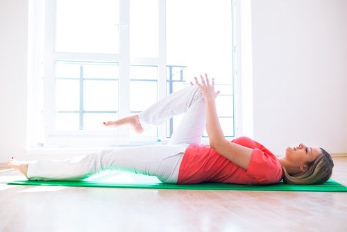 A woman doing knee exercises