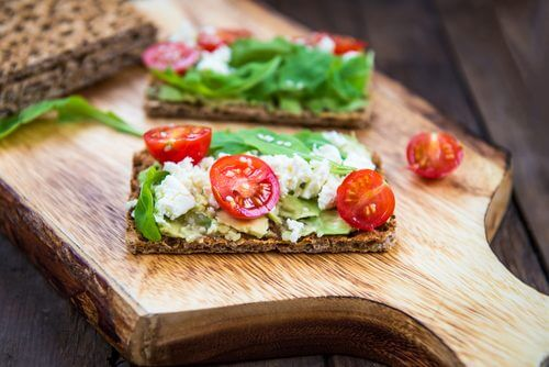 Seed crackers with cheese and tomatoes