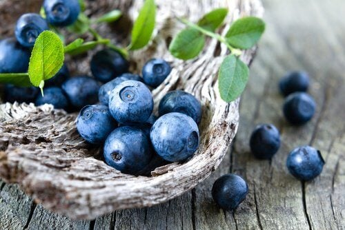 Some blueberries on wood.