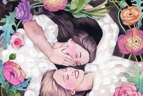 Two women lying down laughing