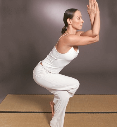 Woman doing the eagle pose