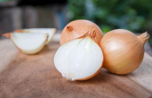 A few onions on a table.