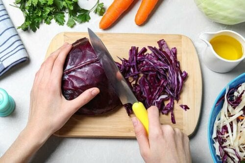 A person chopping red cabbage.