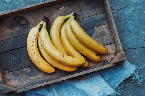 Bananas in a wooden box.