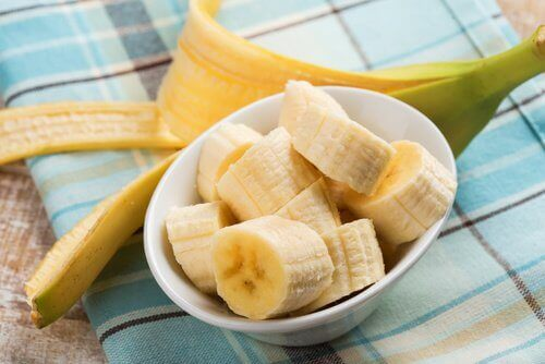 Sliced bananas and banana peel
