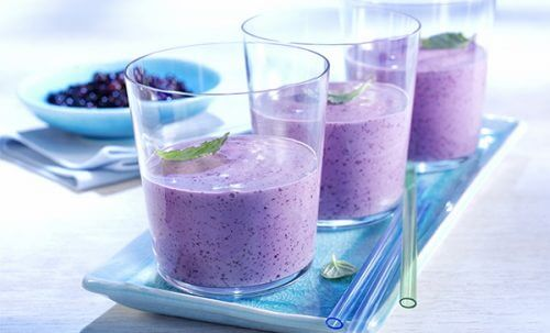 A glass of blueberry smoothie.