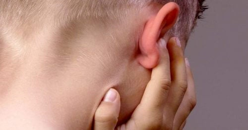 Back of child's head plugging ear