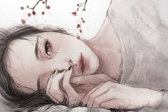 sad woman lying on her side