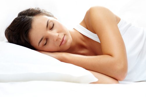 A woman getting a good nights sleep.