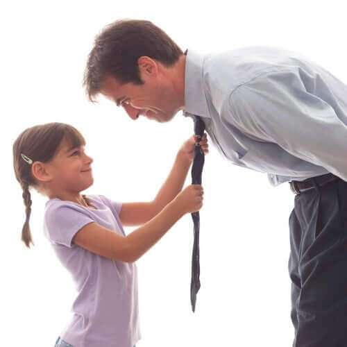 Daughter fixing father's tie strong woman
