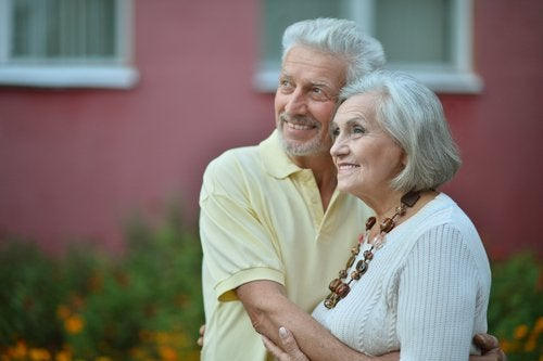 Elderly couple embracing and looking how you age